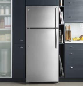 Kitchen interior with a stainless steel fridge