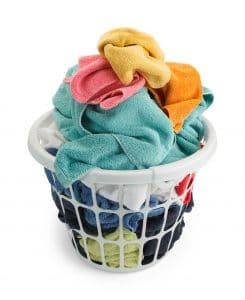 Basket of Unfolded Towels Isolated on White Background.